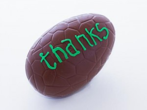 Easter egg piped with the word 'thanks'