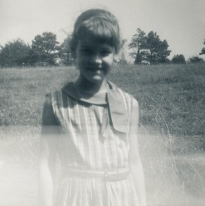 Sarah as a young girl, in a faded image