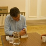 Derek signs a book at a book event